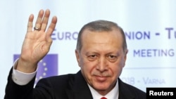 FILE - Turkish President Tayyip Erdogan waves during a news conference at Euxinograd residence, near Varna, Bulgaria, March 26, 2018.