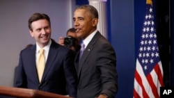 President Barack Obama joins White House press secretary Josh Earnest at his final daily press briefing in the briefing room of the White House in Washington, Jan. 17, 2017.