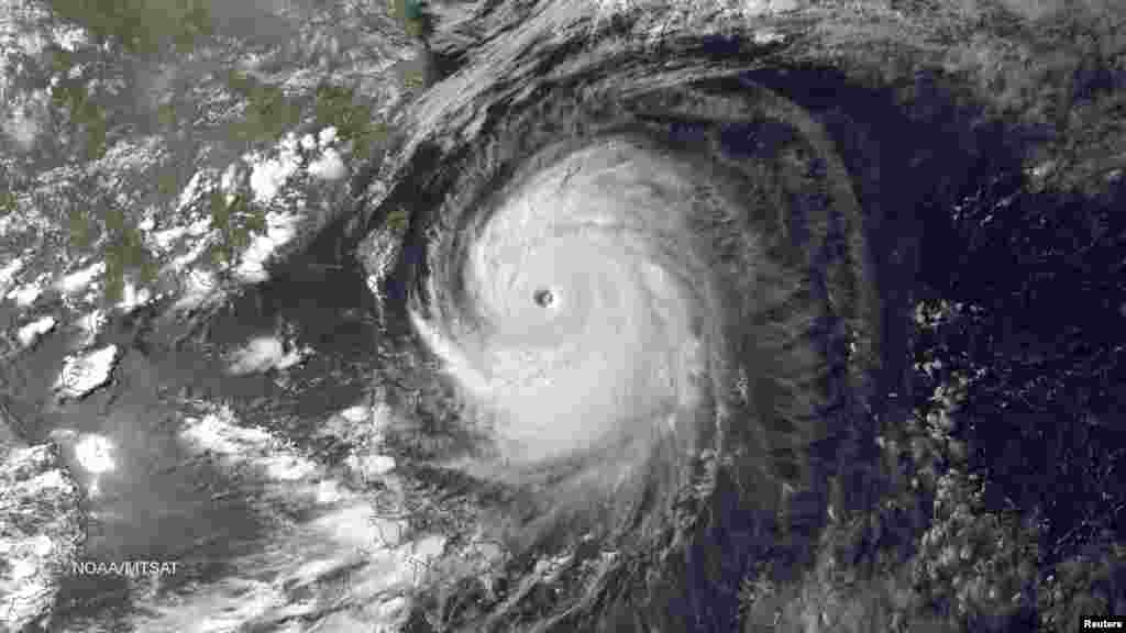 Super Typhoon Neoguri in the Pacific Ocean, approaching Japan on its northward journey, is seen in an image taken by MTSAT-2 satellite on July 7, 2014.