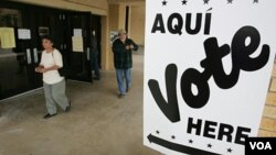 FILE - Hispanic voters leave a San Antonio, Texas, polling place after voting in the 2004 election.