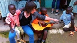 Dave Chapman with children at the Divine Providence Children's Home in Kakamega, Kenya