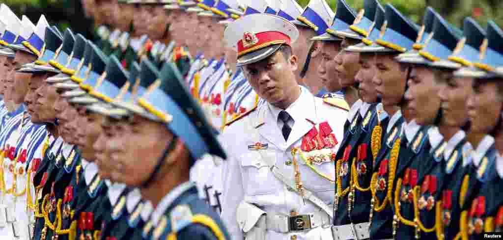 Captain Bui Sy Tung checks the line-up of the honor guard before a welcoming ceremony for Indian President Pranab Mukherjee at the Presidential Palace in Hanoi, Vietnam.