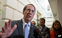 FILE - House Judiciary Committee Chairman Bob Goodlatte, R-Va., speaks with reporters.