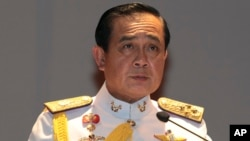 Gen. Prayuth Chan-ocha speaks at the start of his first press conference since the coup, May 26 , 2014, in Bangkok.