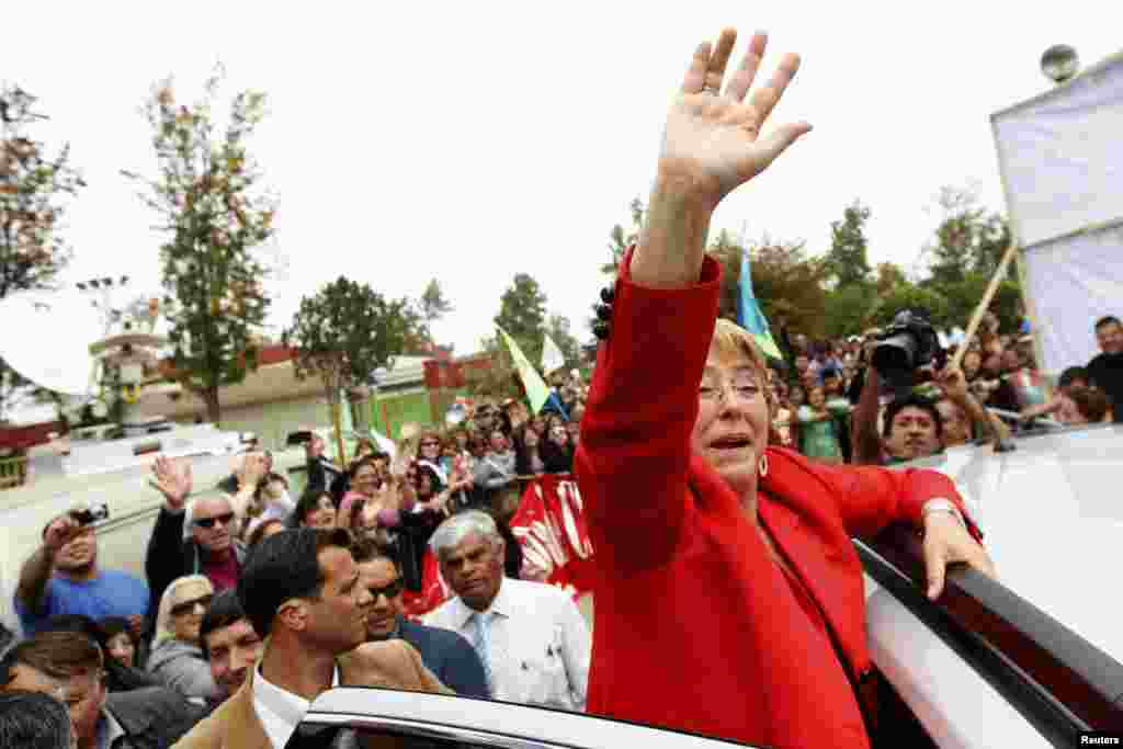 Chilean presidential candidate Michelle Bachelet waves to her supporters during a campaign event in Santiago. Bachelet was the clear winner in the presidential election, although she will have to wait until a second round runoff next month to seal her victory.