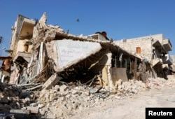 FILE - A damaged building is pictured in Masaken Hanano, Aleppo, April 2, 2014.