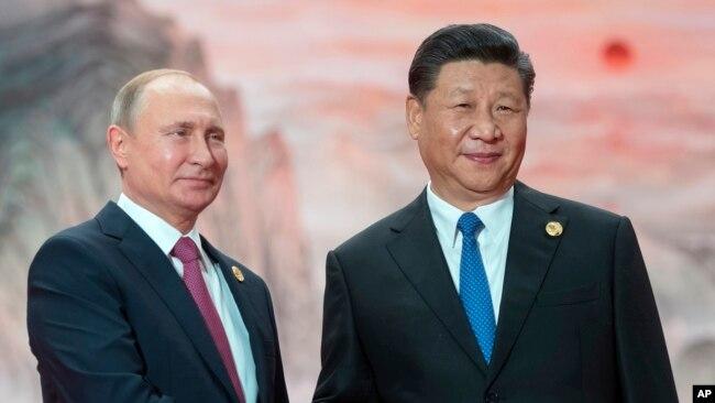 Tổng thống Nga Putin và Chủ tịch Trung Quốc Tập Cận Bình tại Trung Quốc hồi tháng Sáu năm nay.