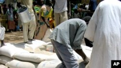 Food aid being distributed by USAID in Sudan. (file)