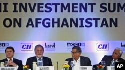 Afghan Foreign Minister Zalmai Rassoul (2nd L) and his Indian counterpart S.M Krishna (3rd L) attend the opening session of the Delhi Investment Summit on Afghanistan in New Delhi, India, June 28, 2012.