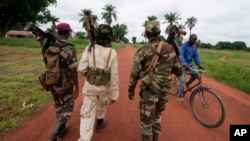 FILE - Members of a rebel group are seen in the town of Bria, Central African Republic, July 15, 2013.