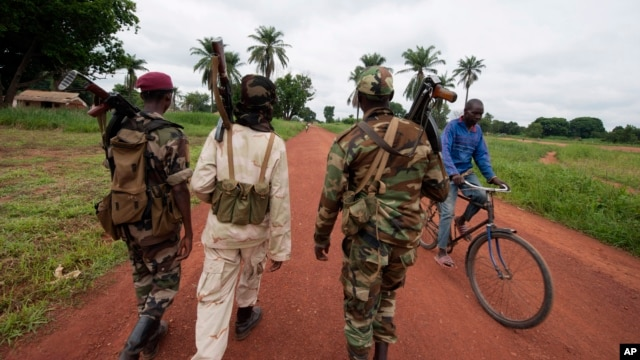Seleka rebels, seen here July 15, 2013, in the town of Bria, Central African Republic, overthrew the previous president in March, and are accused of continuing to carry out atrocities.