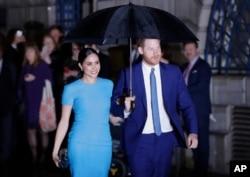 پرنس ہیری اور ان کی اہلیہ میگن، فائل فوٹو