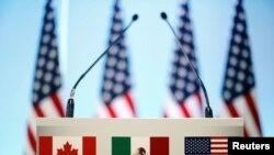 ທຸງຊາດການາດາ ເມັກຊິໂກ ແລະສະຫະລັດ ທີ່ແນມເຫັນຢູ່ກອງປະຊຸມ NAFTA ທີ່ນະຄອນເມັກຊິໂກຊີຕີ້ ວັນທີ 5 ມີນາ 2018.