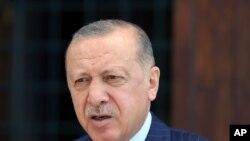 Turkey's President Recep Tayyip Erdogan speaks to the media after Friday prayers, in Istanbul, Aug. 20, 2021.