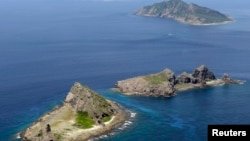 FILE - A group of disputed islands, Uotsuri island (t), Minamikojima (b) and Kitakojima, known as Senkaku in Japan and Diaoyu in China is seen in the East China Sea, in this photo taken by Kyodo September 2012.
