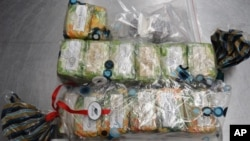 This photo released Tuesday, Aug. 11, 2015 by the Australian Federal Police shows bars of soap filled with cocaine seized from a 91-year-old retired surgeon as he returned home from India.