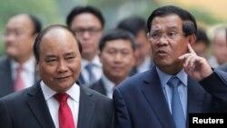 Thủ tướng Việt Nam Nguyễn Xuân Phúc và Thủ tướng Campuchia Hun Sen.