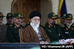 A handout picture released by the official website of the Centre for Preserving and Publishing the Works of Iran's supreme leader Ayatollah Ali Khamenei shows him, center, during a visit to the Imam Hussein Military College in Tehran, May 20, 2015.