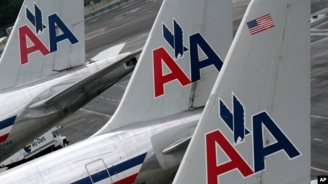 FILE - American Airlines planes at the JFK International Airport in New York.