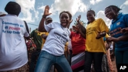 FILE - Women celebrate as their country is declared Ebola-free in Freetown, Sierra Leone, Nov. 7, 2015.