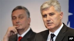 "Dragan Covic , right, leader of ""Croatian Democratic Union"" (HDZ), and Zlatko Lagumdzija , left, leader of Social Democratic party (SDP) address journalists during press conference in Sarajevo, Bosnia, on Wednesday, Dec. 28, 2011. After more than a year o"