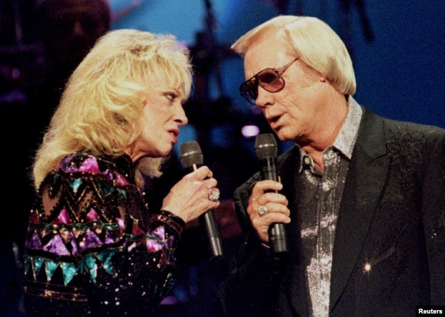 Country singer George Jones, (R) pictured with Tammy Wynette at the Country Music Association Awards in Nashville, Oct. 4, 1995.