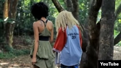 "Two women walk side-by-side in a YouTube screen grab from the controversial ""Same Love"" remix music video by Kenyan recording artists Art Attack and Nicole Florence Kutoto. As of March 17, 2016, the video has had nearly 200,000 views on YouTube."