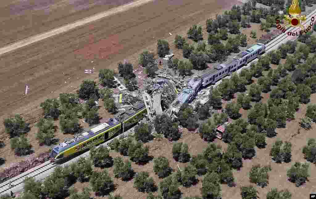 This aerial handout photo by Italian Firefighter Press Office shows two commuters trains after their head-on collision in the southern region of Puglia, Italy. At least 20 people died and several others are reported injured.