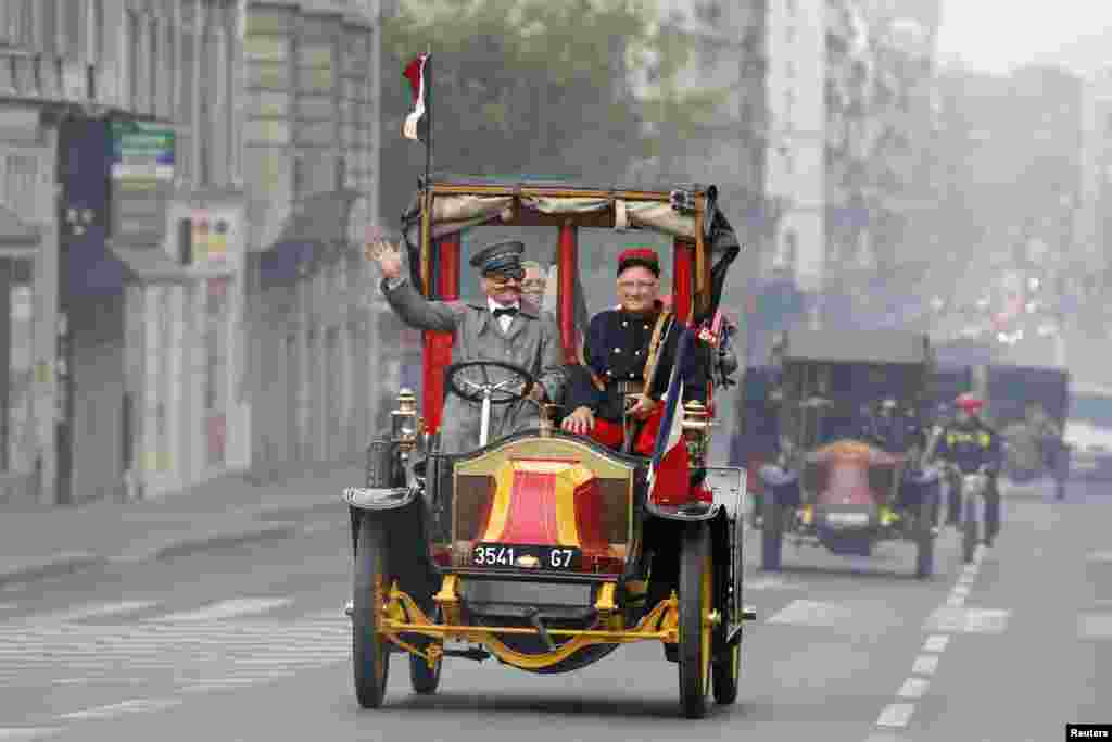 "History enthusiasts ride vintage ""Taxi de la Marne"" during a parade, as part of activities to commemorate the 100th anniversary of the First Battle of the Marne in Paris, France. Parisian taxis were requisitioned by the French Army to transport troops from Paris to the First Battle of the Marne in early September 1914 during WWI."