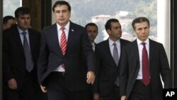 Михаил Саакашвили и Бидзина Иванишвили. Тбилиси. 9 рктября 2012 г.