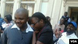 Cynthia Manjoro (right) seen outside the courtroom soon after she was acquitted with 20 others.