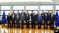 European Commission President Jean-Claude Juncker, front center, poses with EU leaders during a group photo at an informal EU summit on migration at EU headquarters in Brussels, June 24, 2018.