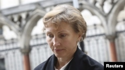 FILE - Marina Litvinenko, the widow of murdered KGB agent Alexander Litvinenko, leaves the High Court in central London, July 28, 2015.