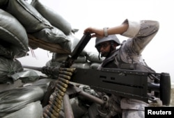 A Saudi soldier loads ammunition from a position at Saudi Arabia's border with Yemen, April 6, 2015.