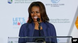 "FILE - First lady Michelle Obama speaks at a Miami parks and recreation center to promote her ""Let's Move"" campaign, Feb. 25, 2014."