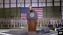 President Barack Obama speaks to the troops at a rally during an unannounced visit at Bagram Air Field in Afghanistan, 03 Dec 2010