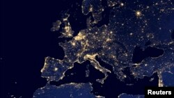 FILE - A nighttime view of Europe and North Africa is seen in a global composite assembled from data acquired by the Suomi National Polar-orbiting Partnership satellite in 2012.