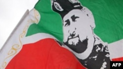 FILE - A flag depicts Ramzan Kadyrov, the Kremlin-backed president of Russia's predominantly Muslim province of Chechnya.
