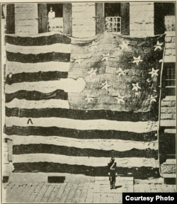 A soldier guards the original Fort McHenry. Note his size and that of the flag. (Wikipedia Commons)