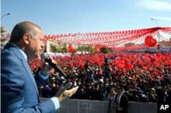 Turkey's President Recep Tayyip Erdogan addresses his supporters during a referendum rally in Sanliurfa, Turkey, April 11, 2017.