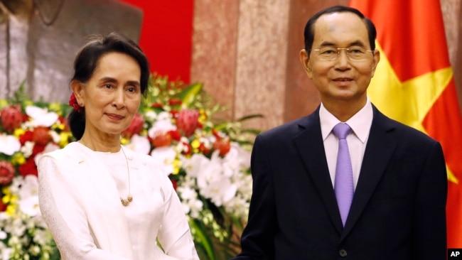 Ông Trần Đại Quang tiếp đón lãnh đạo Miến Điện, bà Aung San Suu Kyi, ở Hà Nội hôm 13/9.