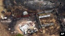 5일 호주 남부 태즈메이니아 주 호바트에서 불에 탄 주택과 자동차.