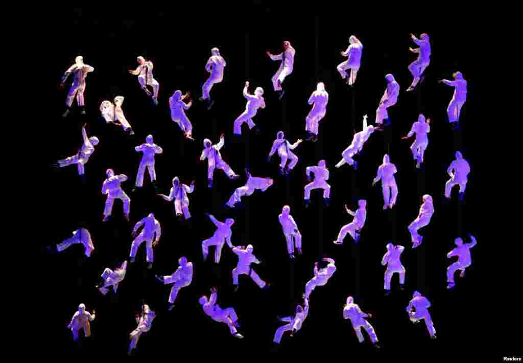 "Aerobatic dancers under the direction of Spanish theatrical company La Fura dels Baus perform in ""The Rise of the Tritons"" during the opening of Valletta 2018, European Capital of Culture, in Valletta, Malta, Jan. 20, 2018."