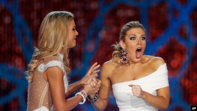 Miss New York, Mallory Hagan, right, reacts with Miss South Carolina Ali Rogers as she is crowned Miss America 2013 on Jan. 12, 2013, in Las Vegas.