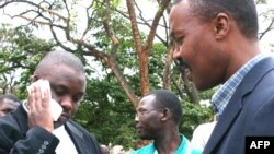 FILE - Erias Lukwago (L) and Forum for Democratic Change (FDC) representative Maj. Gen. Mugisha Muntu (R).