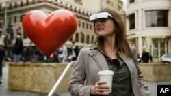 Yvonne Felix wears eSight electronic glasses and looks around Union Square during a visit to San Francisco, Feb. 2, 2017. The glasses enable the legally blind to see. Felix was diagnosed with Stargardt's disease after being hit by a car at age 7.