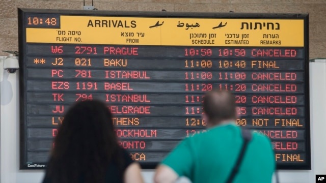 Arrival flight board displays various canceled and delayed flights in Ben Gurion International airport a day after the U.S. Federal Aviation Administration imposed a 24-hour restriction on flights to the region, July 23, 2014.