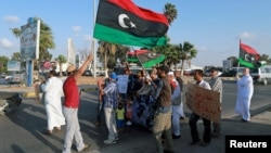 FILE - Protesters demonstrate against the U.N. draft agreement for a political settlement between the parallel governments in Libya, in Benghazi, Sept. 18, 2015.