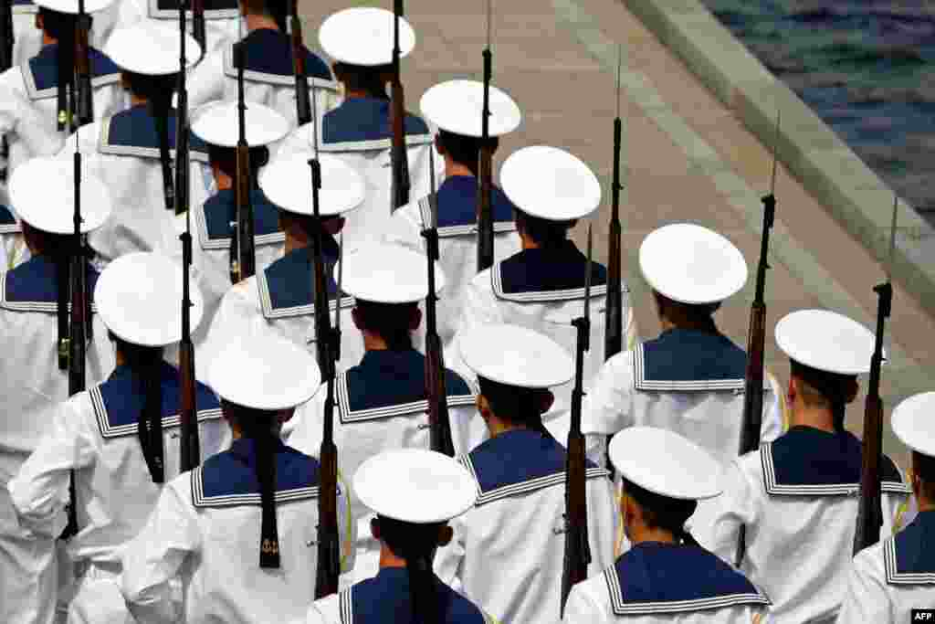 Sailors of the Russian Black Sea Fleet march as they prepare for Navy Day celebrations in the Crimean city of Sevastopol. Russia announced Wednesday that it had begun expanding and modernizing its Black Sea fleet based in Crimea with new ships and submarines.