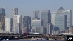 FILE - London's financial district in Canary Wharf, London, March 25, 2020.
